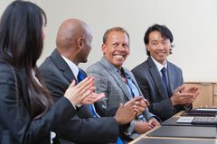 Professionals applauding Royalty Free Stock Photography