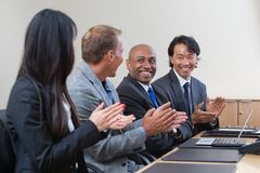 Professionals applauding during a business meeting Stock Photo