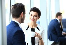 Professionals chatting during a coffee break. Young couple of professionals chatting during a coffee break stock images