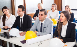 Professionals and coach at design training Royalty Free Stock Photo