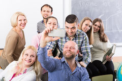 Professionals and coach making group portrait. Happy professionals and coach making group portrait at the school Royalty Free Stock Image