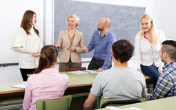 Professionals and coach at training royalty free stock photo