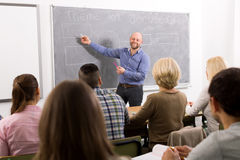 Professionals and coach at training stock images