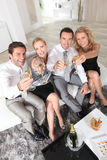 Professionals holding champagne glasses Royalty Free Stock Photography