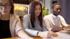 The professionals prerapes for important business negotiations in the expensive restaurant. afroamerican businessman. In white suit work on the barnd new laptop stock video