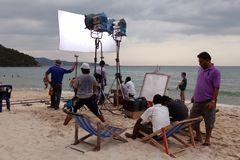 Professionals shoots film on the coast Stock Photography