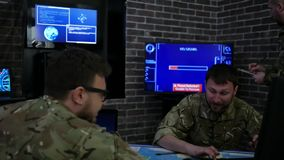 Professionals soldiers in uniform, in field headquarters, Cyber stock footage