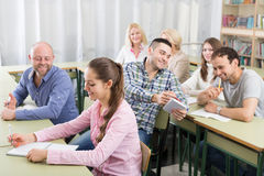 Professionals taking notes at training session Royalty Free Stock Photo