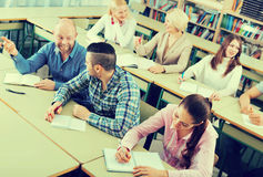 Professionals taking notes at training session Stock Images