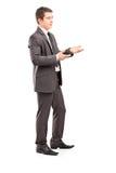 Professioneel die mannetje tijdens een gesprek wordt geschoten royalty-vrije stock afbeeldingen