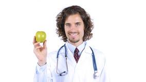 Professionele arts met groene appel in handen royalty-vrije stock foto's