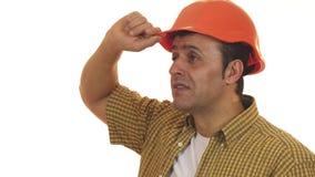 Professionele contractant die geschokt dragend bouwvakker kijken stock foto's