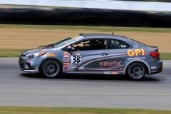 Professionele Kia Forte Koup-raceauto op de cursus Stock Foto