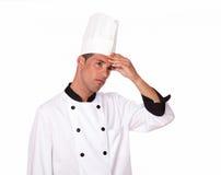 Professionele knappe volwassen chef-kok met hoofdpijn royalty-vrije stock afbeelding