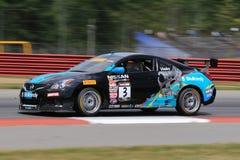 Professionele Nissan Altima-raceauto op het spoor Stock Afbeeldingen