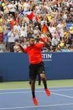 Professionele tennisspeler Jo-Wilfried Tsonga die overwinning na US Open 2014 ronde gelijke 3 vieren Stock Afbeelding