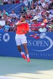 Professionele tennisspeler Jo-Wilfried Tsonga tijdens US Open 2014 eerste ronde gelijke Stock Foto's