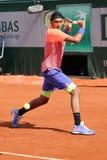 Professionele tennisspeler Nick Kyrgios van Australië in actie tijdens zijn derde ronde gelijke in Roland Garros 2015 Royalty-vrije Stock Foto's