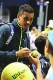 Professionele tennisspeler Nick Kyrgios van Australië die autographs na winst ondertekenen bij US Open 2014 gelijke Royalty-vrije Stock Fotografie