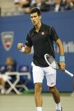 Professionele tennisspeler Novak Djokovic tijdens kwartfinalegelijke bij US Open 2013 tegen Mikhail Youzhny Royalty-vrije Stock Fotografie