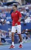 Professionele tennisspeler Novak Djokovic tijdens vierde ronde gelijke bij US Open 2013 tegen Marcel Granollers Royalty-vrije Stock Foto