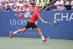 Professionele tennisspeler Victor Estrella Burgos tijdens derde ronde gelijke tegen Miols Raonic bij US Open 2014 Royalty-vrije Stock Fotografie