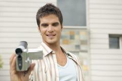 Professionista con la videocamera Fotografie Stock Libere da Diritti