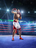 Professionl boxer is standing on the ring Stock Photography