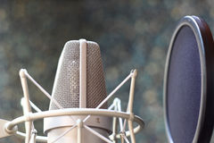 Professionl microphone. A professional microphone in a recording studio stock photography
