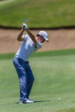 Professionnel Tommy Fleetwood Swinging de golf Image libre de droits