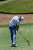 Professionnel Tommy Fleetwood Swinging de golf Photographie stock