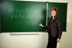 Professor against blackboard background Stock Image