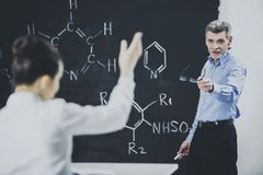 Professor Ask Student About Chemistry Formula. Teacher Leading Lecture. University Classroom. Educational Concept. Explanation for students. Educarion Process stock photography