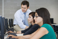 Professor Assisting Computer Students Royalty Free Stock Photo