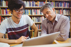Professor assisting a student with studies Stock Photography
