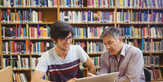 Professor assisting a student with studies Royalty Free Stock Photography
