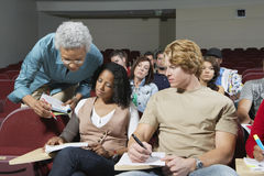 Professor Assisting Students In Class Royalty Free Stock Photos