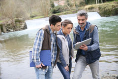 Professor with biology students outdoors Royalty Free Stock Image