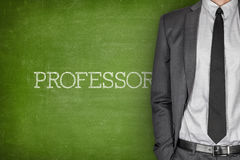 Professor on blackboard Stock Image