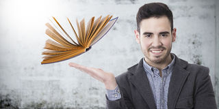 Professor with the book. Concept of learning and education stock images