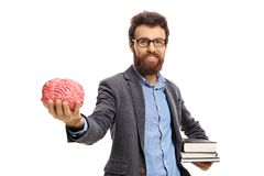 Professor with books and a brain model. Isolated on white background royalty free stock images