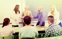 Professor chatting with students royalty free stock photography
