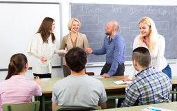 Professor chatting with students. Professor chatting with her students during a break Stock Images