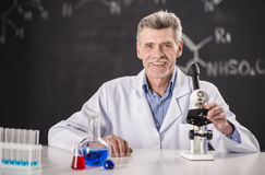 Professor. Chemistry or science concept. Senior chemistry professor working in laboratory royalty free stock photos
