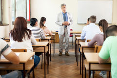 Professor with class. Professor lecture his students in classroom stock image