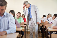Professor with classroom full of students Royalty Free Stock Photo