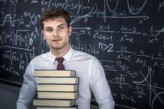 Professor com livros imagem de stock