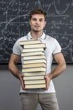 Professor com livros imagem de stock royalty free