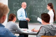 Professor com os estudantes da High School Fotografia de Stock Royalty Free
