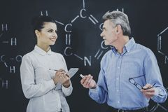 Professor Consultates Student About Chemistry. Professor Consultate Student About Chemisry. Teacher Explain in University. Educational Concept. Teaching Process royalty free stock photo